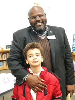 Ray with one of his sons.