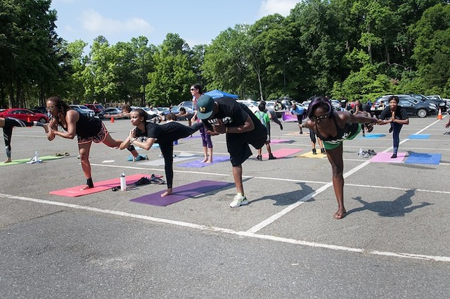 Doing yoga at last year's walk. (Photo by Jon Strayhorn)
