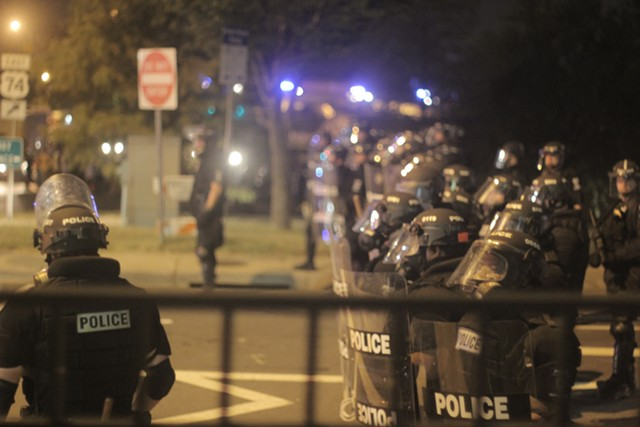Police gather during the Charlotte Uprising in September 2016. (Photo by Ryan Pitkin)