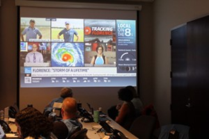 Experts in the Emergency Operations Center in Charlotte look on as Florence bears down on Charlotte. (Photo by Courtney Mihocik)
