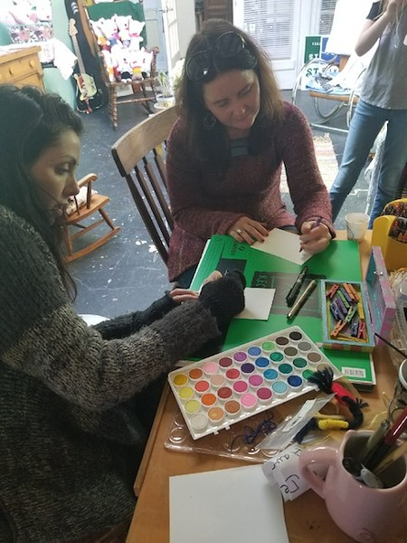 Lauren Kestner (left) collages with Hillary Belk, fellow co-founder of R Creative Collective (Photo courtesy of Lauren Kestner)