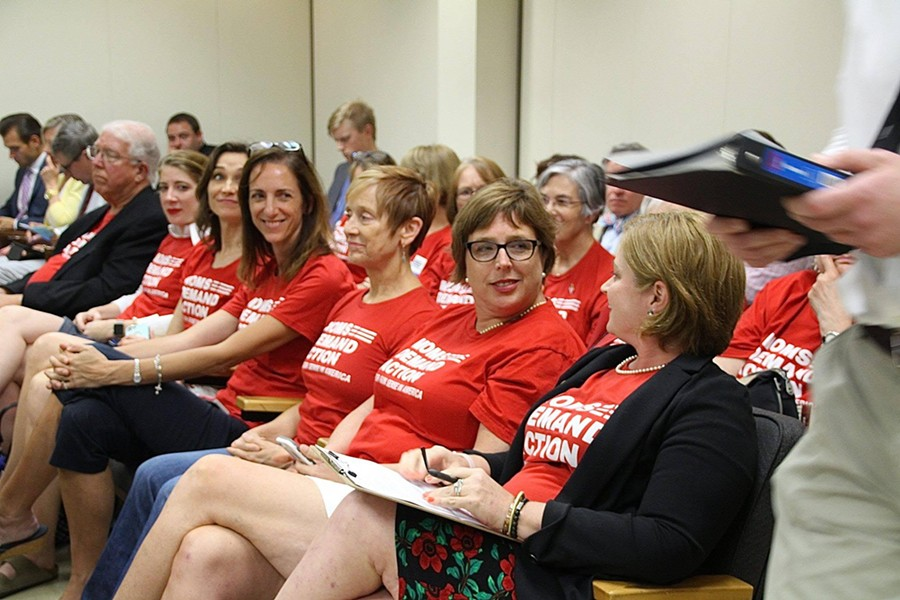 Christy Clark (far right) and other members of Moms Demand Action North Carolina chapter say they will continue to show up in Raleigh on a daily basis to fight against HB 746. - PHOTO COURTESY OF CHRISTY CLARK.