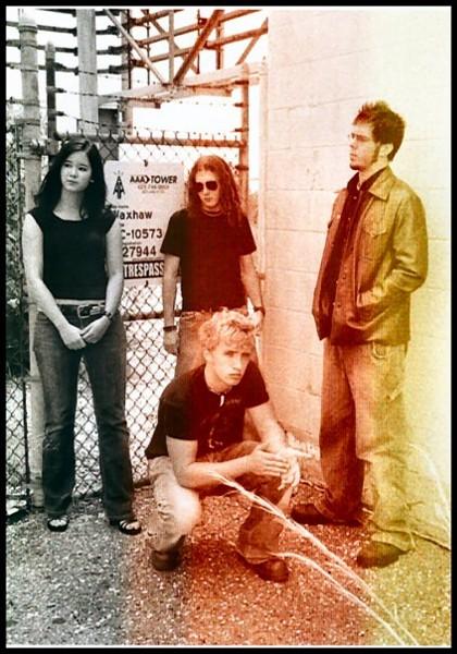 Sugar Glider in 2005: Emily Aoyagi, Chris Rigo, Cory Lambert (standing) and Howie (stooping).