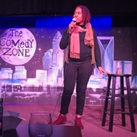 Stacilou Askew performing a set at The Comedy Zone