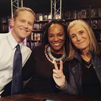 James Tyson (left) and Bree Newsome (center) pose with Amy Goodman of Democracy Now!