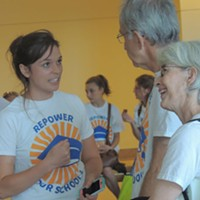 Hanna Mitchell speaks with fellow Repower Our Schools supporters before delivering a petition to the CMS Board of Education.