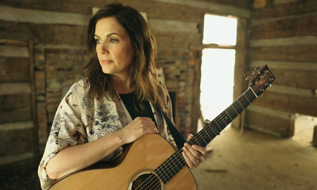 Lori Mckenna poses with her acoustic guitar. (Photo by Becky Fluke)
