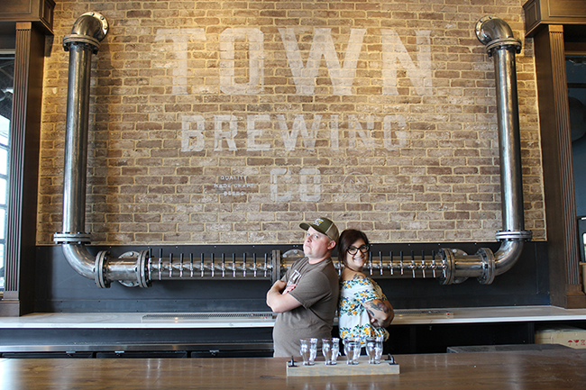 Brian Quinn (left) and Heather Wendrow behind the new bar in the taproom. (Photo by Courtney Mihocik)