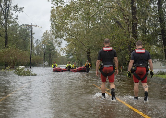 Rescuers carry out efforts in Elizabeth City following Hurricane Florence. (Photo by Dustin Williams/USCG)