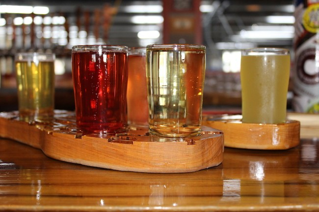 Two flights of cider on custom-made flight paddles at Red Clay.