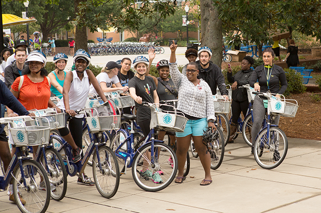 Dianna Ward (in blue shorts) gets ready to leave during a recent back-to-school ride at Johnson C. Smith University. (Photo by Michael Hernandez)
