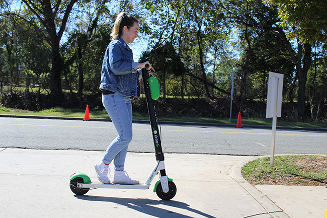 'CL' intern Veronica Cox cuts it up on a scooter. (Photo by Courtney Mihocik)
