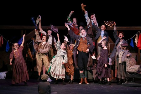 Rob Addison as Fagin with his band of juvenile thieves. (Photo by Chris Record)