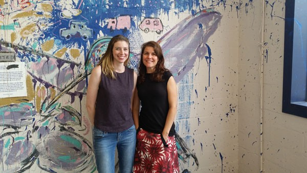 Amy Herman (left) and Amy Bagwell are co-directors for the Skyline series project underway at the former Goodyear spot. (Photo by Anita Overcash)