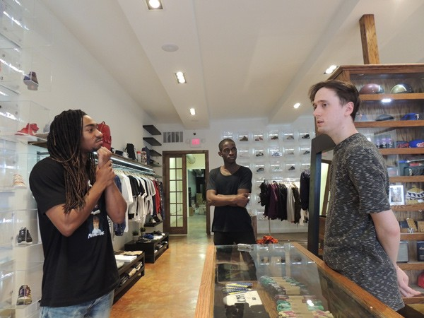 (From left) Vadoll Byers, Jeffrey Sekyere and Alex Brown discuss sneaker culture in Social Status, a boutique in Plaza Midwood. (Photo by Ryan Pitkin)