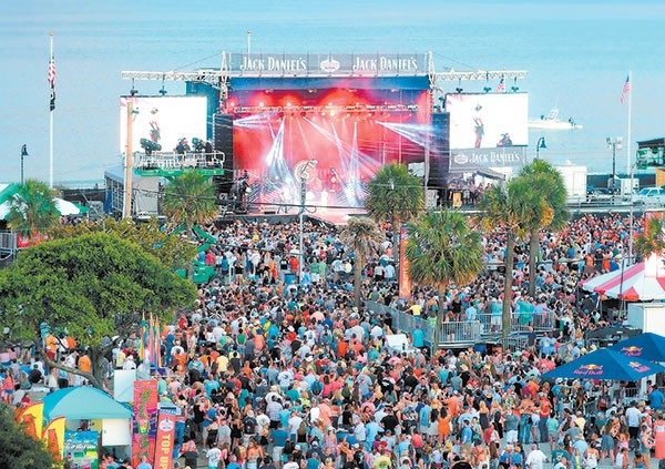 One of the main stages at Carolina Country Music Fest sits with its back to the Atlantic Ocean.