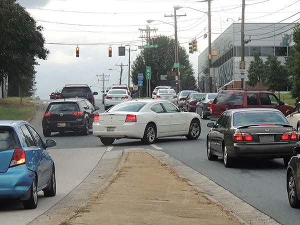 Cars fight to get to their desired turn lanes in the 125 feet between an I-277 off-ramp and the intersection of 12th and North Davidson streets, the seventh-worst in Charlotte, according to a recently released CDOT report.