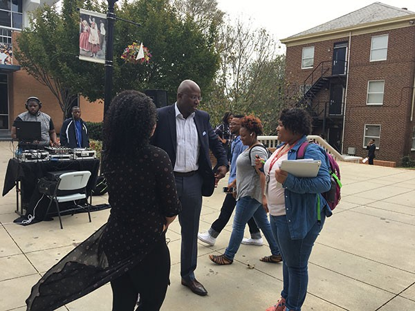 Reggie Love speaks with students at Johnson C. Smith University. - ROBYN PATTERSON