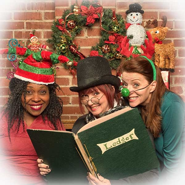 (From left) Tanya McClellan as Charlie In The Box, Sheila Snow Proctor as Scrooge and Lane Morris as Gustav the Green-nosed Reingoat.