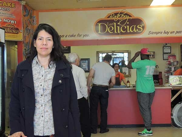 Zhenia Martinez in her business, Las Delicias Bakery, which she shut down to join the Day Without Immigrants march. - RYAN PITKIN