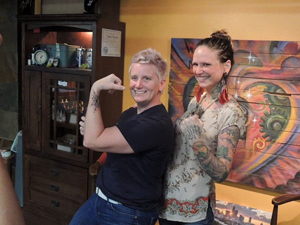 Jodi Winterton (left) shows off her Time Capsule Tattoo with Moran. - MELISSA MCHUGH