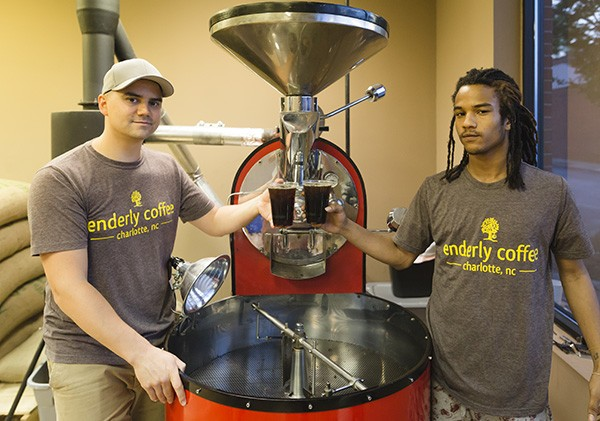 Tony Santoro (left) and Marquell Pettiford hold cups of brewed Enderly Coffee.