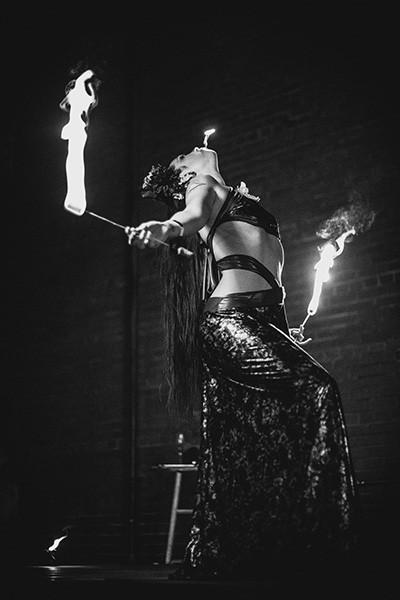 Jen Burden balances flames.