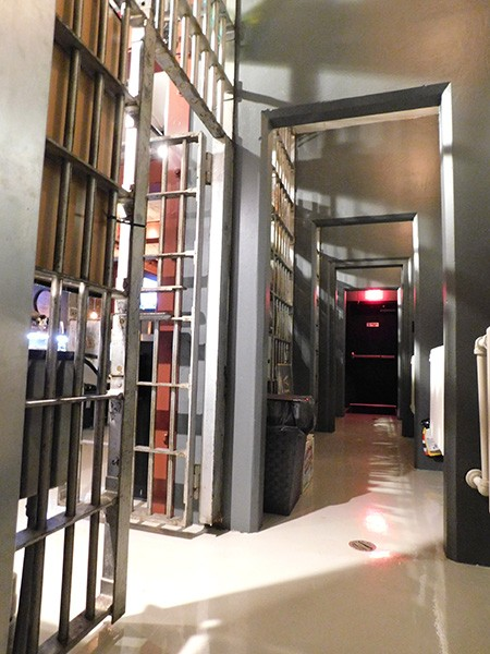 Holding cells behind the bar are mostly used as storage today.