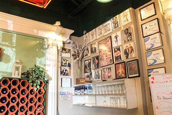A portion of the wall in Skyland pays homage to old-school professional wrestlers, a passion of Jimmy's. (Photo by Alexandria Sands)