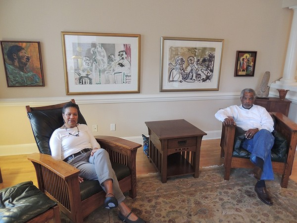 "The Diamonds in their living room, where the first piece they acquired in America, Romare Bearden's ""Brass Section,"" hangs (second from right)."