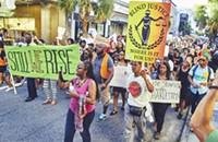 #BlackLivesMatter marchers speak outside of Confederate Museum