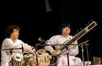 Hussain and sitarist Niladri Kumar perform in Charlotte
