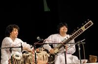Hussain and sitarist Niladri Kumar perform in Charlotte