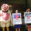 Activists and Abby, a big bird with big problems, visit Uptown Harris Teeter