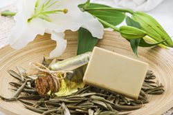 Soap on a plate with Easter Lily, rosemary, and bottled oil - Uploaded by ajnewso2