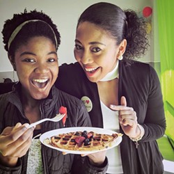 Carlissa Cook and Coach Carmen eating a plate of Wellness Waffles only at Fit Power Nutrition - Uploaded by TheMediaBlast
