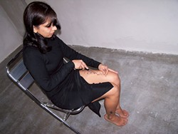 "Regina Jose Galindo cuts herself for her ""Perra/Bitch"" performance art piece. (Photo by Kika Karadi)"