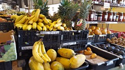 Non-local items including bananas and pineapples can be found near the N.C.-grown produce. (Photo by Alison Leininger)