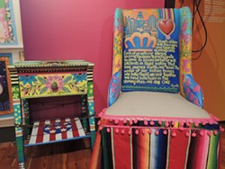 A seat designed by Rosalia Torres-Weiner, an artist and muralist who emigrated from Mexico City to Charlotte, displayed in the ¡NUEVOlution! exhibit at the Levine Museum of the New South.
