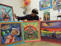 "Rosalia Torres-Weiner in her studio with some of the ""Magic Kite"" panels. (Photo by Ryan Pitkin)"