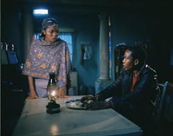 BLID ALSBIRK / MIRAMAX - UNINVITED GUEST Tsotsi (Presley Chweneyagae) forces his way into the home of a single mom (Terry Pheto) in Tsotsi.