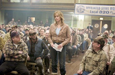 UNION CITY BLUES Josey Aimes (Charlize Theron) talks while local yahoos gawk in North Country (Warner)