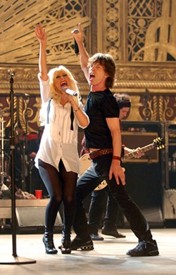 KEVIN MAZUR / PARAMOUNT CLASSICS - UP WITH MUSIC: Mick Jagger performs with Christina Aguilera in Shine a Light.
