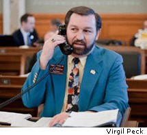 Virgil Peck, seen here wearing his nicest suit, thinks it'd be funny to shoot Latinos from a helicopter. That Virgil — what a character.