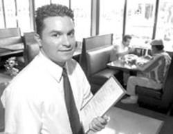 RADOK - Waiter David Morales is ready to show patrons  to a - table at Inka Grill -  - Inka Grill - Peruvian and Latin American Cuisine - 5917 Albemarle Road - 704-537-4655 - Sunday-Thursday  10am-9pm; - Friday & Saturday  10am-10pm. - Saturday night dancing  to salsa, merengue,  and - Peruvian music. - Visa, MC