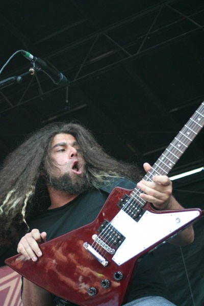 WARPED MINDS: Coheed and Cambria's Claudio Sanchez gets the crowd, and his hair, going during the Vans Warped Tour at Verizon Wireless Amphitheatre on July 23. - JEFF HAHNE