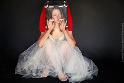 WATTS IN THE BOX?: Conceptual artist Nicky Watts, who travels the world with her head in a box, will be part of the Queen City Fringe Festival Oct. 3-6.