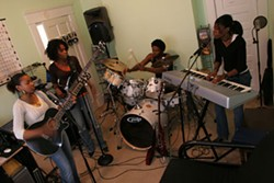 We are family: Elesha (from left), Adrienne, Rufus and Kristen Barnette in their cramped practice room. - CATALINA KULCZAR