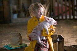 LISA TOMASETTI / PARAMOUNT - WHAT A BABE Wilbur gets pampered by Fern (Dakota Fanning) in Charlotte's Web