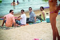 UNIVERSAL - WHERE THE BOYS ARE: Chris Klein, Jason Biggs, Eddie Kaye Thomas and Thomas Ian Nicholas enjoy the sun in American Reunion.